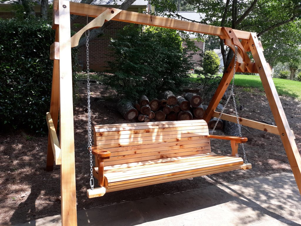 Outdoor swing with stand.