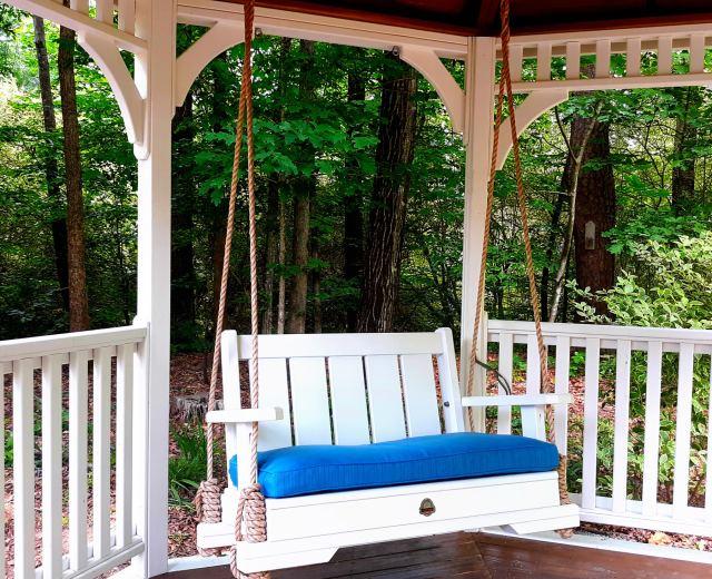 White Porch Swing in Gazebo